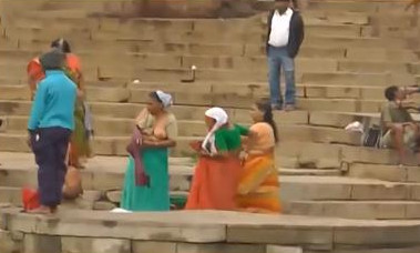 Indian aunties doing holy dip