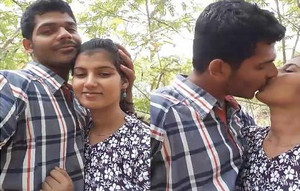 Cute Indian Lovers kissing outdoor