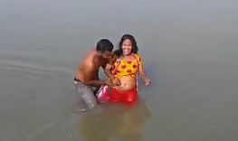 desi indian couple having fun in water