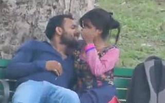 Desi couple kissing in park recording