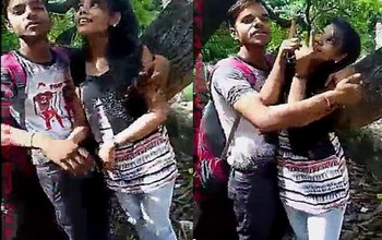 Hot Indian college lovers kissing in outdoor park