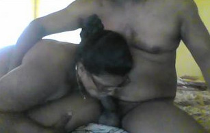 amateur Indian housewife in glasses bows and gives head