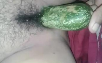 Indian bhabhi inserts cucumber inside pussy