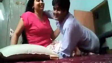 Newly married Indian couple enjoying in bedroom