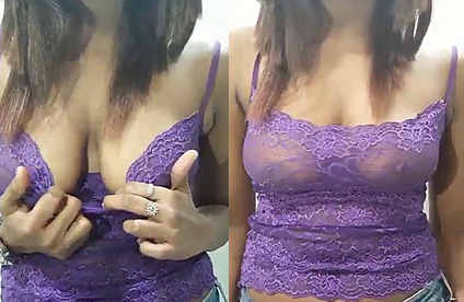 krisha in violet top pressing her boob and talking