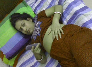 Beautiful Indian wife dress changing and peeing