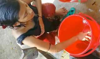 Desi Hot village girl bathing outside