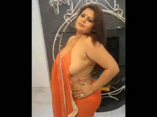 Sapna bhabhi removing her orange saari very big boobies
