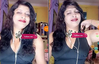 Bhabi Pegs down ,Showing big boobs cleavage in black dress
