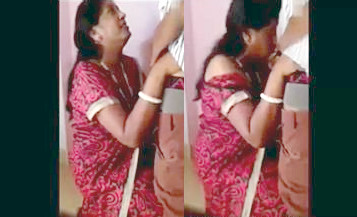 Indian aunty in red saree giving the best blowjob to hubby