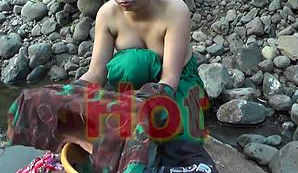 Young girl bathing in jungle showing hot bareback and cleavage